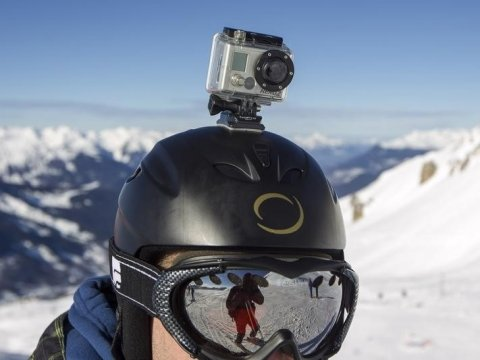 a-gopro-camera-is-seen-on-a-skiers-helmet-as-he-rides-down-the-slopes-in-the-ski-resort-of-meribel-french-alps-january-7-2014-reutersemmanuel-foudrot